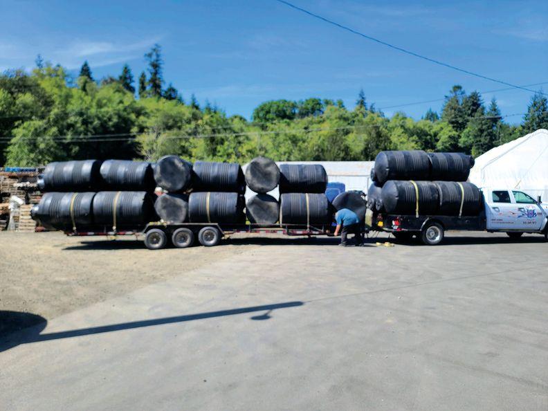 Trucks holding water tanks in Klamath Falls, Oregon.