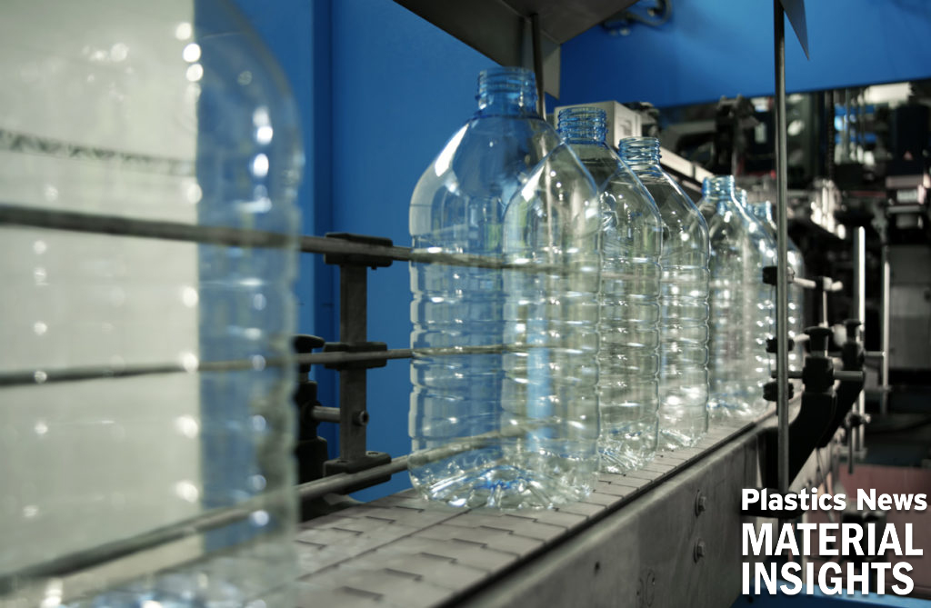 Water bottles are manufactured on a line.